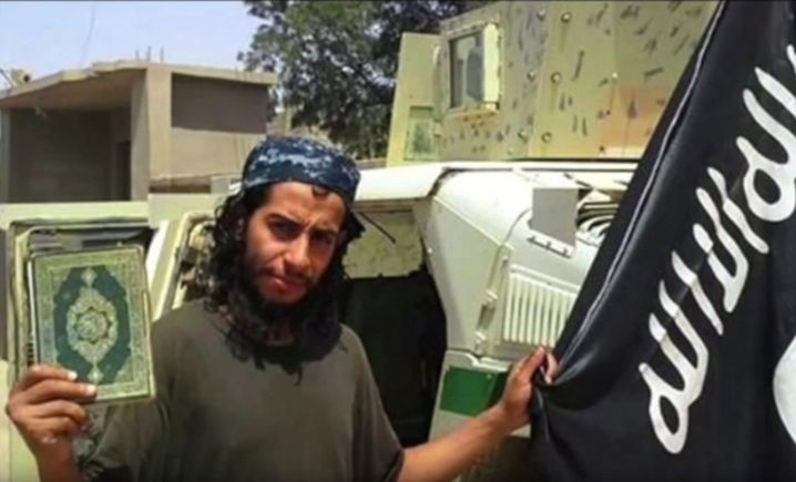 epa05032536 A framegrab made from an undated video released by the jihadist group calling itself Islamic State (IS) allegedly showing Abdelhamid Abaaoud posing with a Koran and the ISIS flag at an undisclosed location. According to French officials, Belgian-born Abdelhamid Abaaoud was identified as among those killed in the police raids in Saint Denis November 18. EPA/ BEST QUALITY AVAILABLE. ATTENTION EDITORS : EPA IS USING AN IMAGE FROM AN ALTERNATIVE SOURCE AND CANNOT PROVIDE CONFIRMATION OF CONTENT, AUTHENTICITY, PLACE, DATE AND SOURCE. HANDOUT EDITORIAL USE ONLY/NO SALES HANDOUT EDITORIAL USE ONLY/NO SALES +++(c) dpa - Bildfunk+++