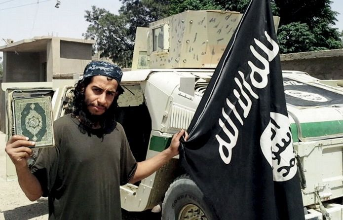 """An undated photograph of a man described as Abdelhamid Abaaoud that was published in the Islamic State's online magazine Dabiq and posted on a social media website. A Belgian national currently in Syria and believed to be one of Islamic State's most active operators is suspected of being behind Friday's attacks in Paris, acccording to a source close to the French investigation. """"He appears to be the brains behind several planned attacks in Europe,"""" the source told Reuters of Abdelhamid Abaaoud, adding he was investigators' best lead as the person likely behind the killing of at least 129 people in Paris on Friday. According to RTL Radio, Abaaoud is a 27-year-old from the Molenbeek suburb of Brussels, home to other members of the militant Islamist cell suspected of having carried out the attacks. REUTERS/Social Media Website via Reuters TVATTENTION EDITORS - THIS PICTURE WAS PROVIDED BY A THIRD PARTY. REUTERS IS UNABLE TO INDEPENDENTLY VERIFY THE AUTHENTICITY, CONTENT, LOCATION OR DATE OF THIS IMAGE. FOR EDITORIAL USE ONLY. NOT FOR SALE FOR MARKETING OR ADVERTISING CAMPAIGNS. FOR EDITORIAL USE ONLY. THIS PICTURE WAS PROCESSED BY REUTERS TO ENHANCE QUALITY. - RTS7CLF"""