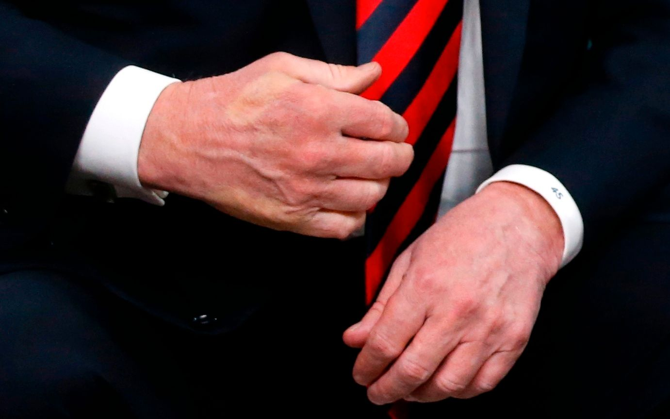 Reuters Trump Macron Hands G7 3