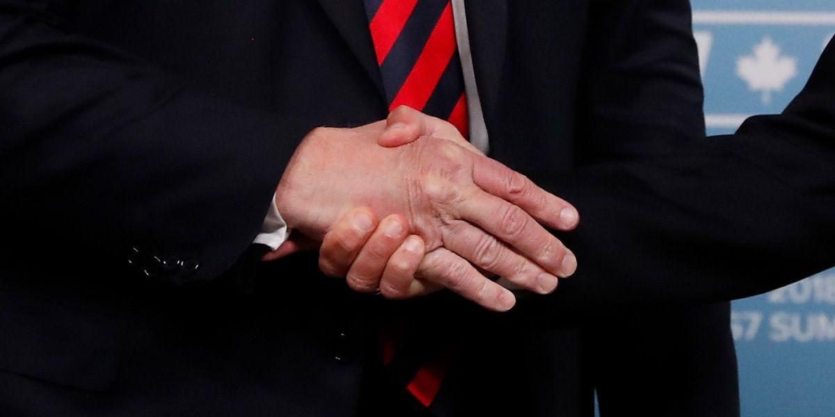 Trump Macron Hand