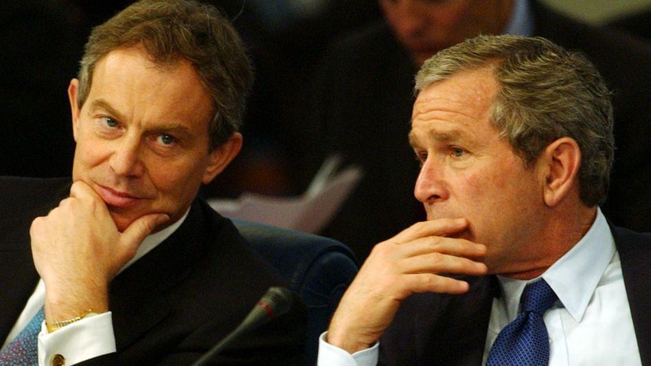 """Tony Blair und George W. Bush (Archivbild): """"Die Welt destabilisiert und polarisiert"""""""
