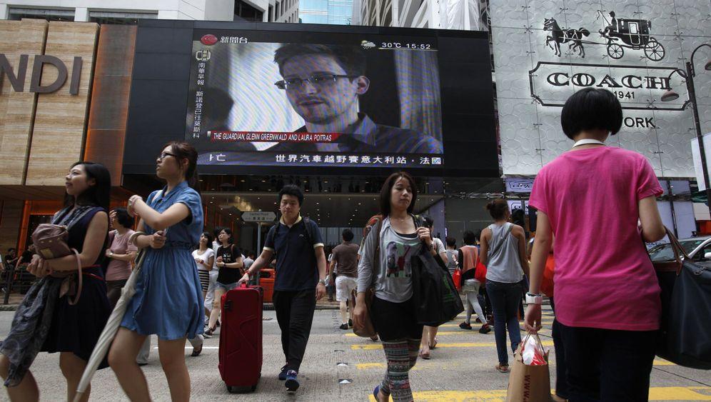 Photo Gallery: A Whistleblower on the Run