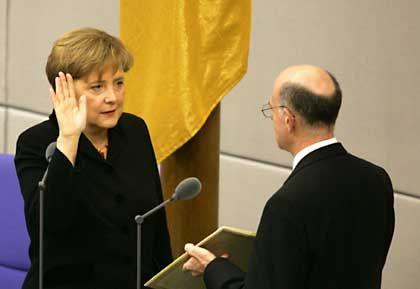 Angela Merkel is sworn as chancellor in parliament in Berlin.