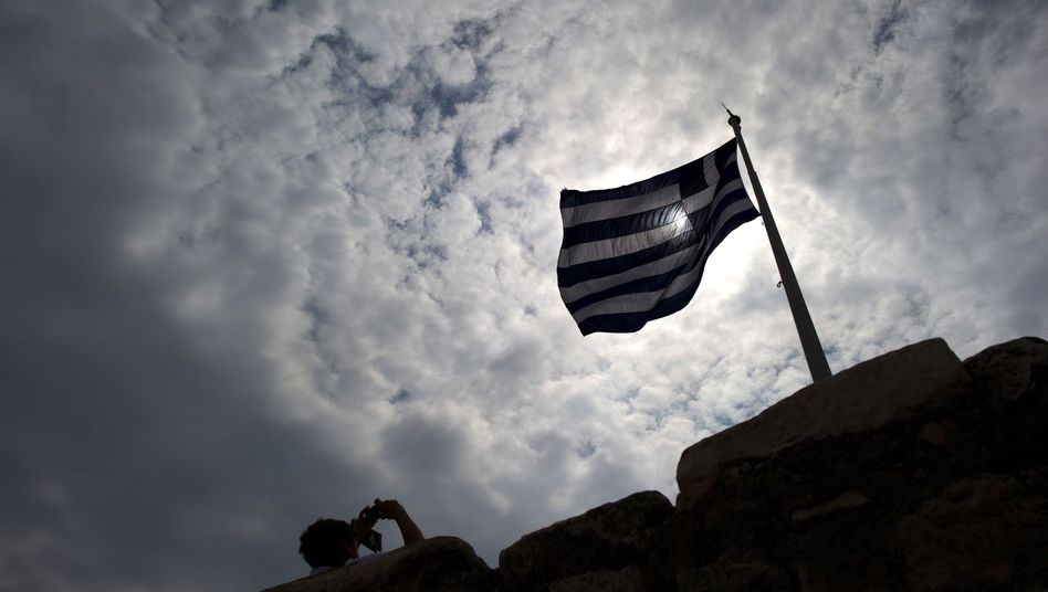 A Greek flag flies at the Acropolis in Athens. 'The banks have been stalling for time,' Hau says.