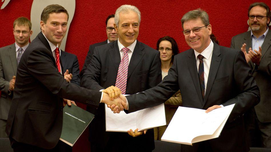 SPD-Abgeordneter Dulig, CDU-Politiker Tillich und Kupfer: Der Regierungspakt steht
