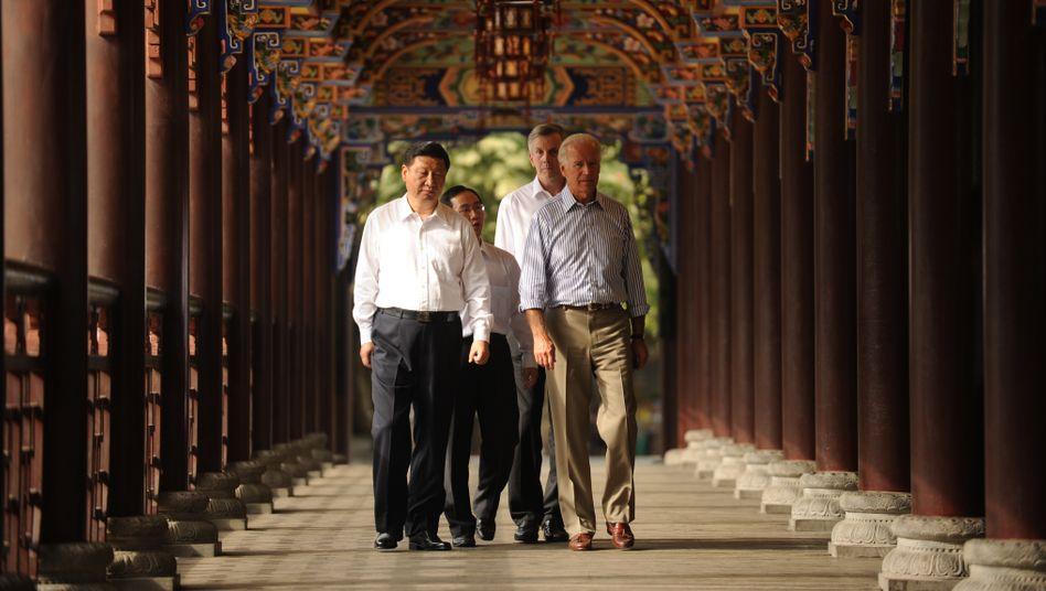 Xi Jinping und Joe Biden im chinesischen Chengdu 2011, damals beide als Vizepräsidenten ihrer Länder