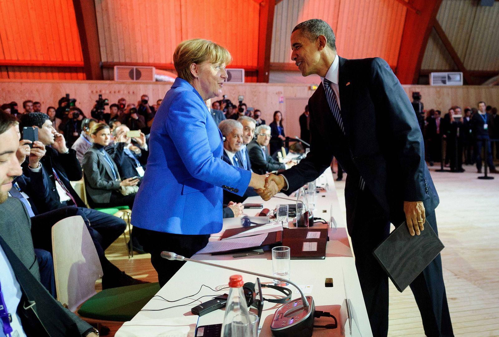 Nov 30 2015 Le Bourget France U S President Barack Obama greets German Chancellor Angela Mer