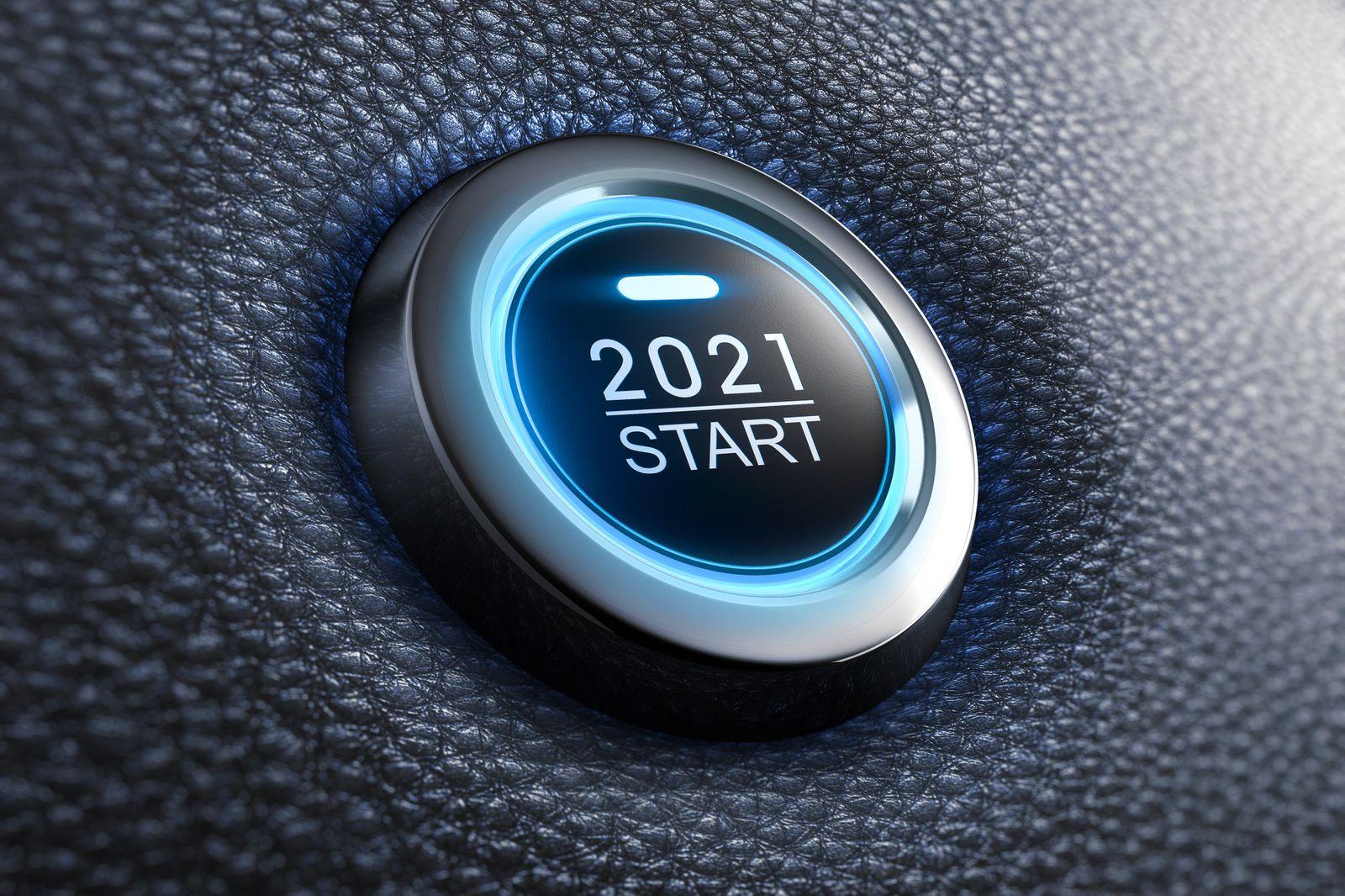 Blue illuminated start 2021 button on black leather