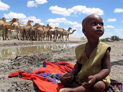 Junge in Kenia: Bei steigender Temperatur drohen Überschwemmungen, Dürren, mehr Infektionskrankheiten