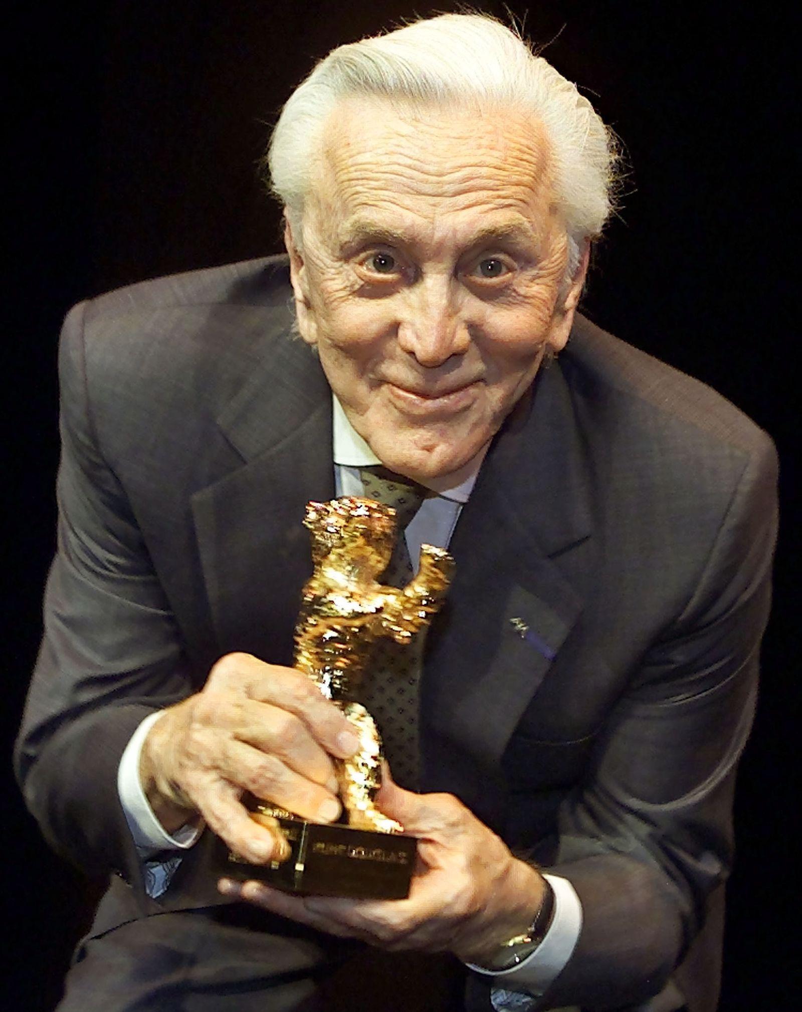 US ACTOR KIRK DOUGLAS RECEIVES GOLDEN BEAR AWARD AT BERLINALE FILM FESTIVAL IN BERLIN.