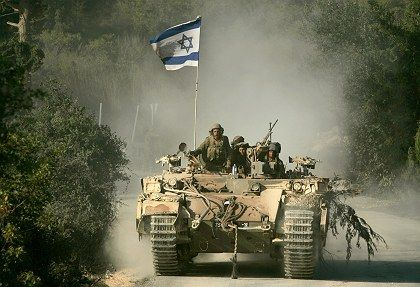 """An Israeli tank returning to northern Israel from southern Lebanon in 2006: """"Now we're on our own."""""""
