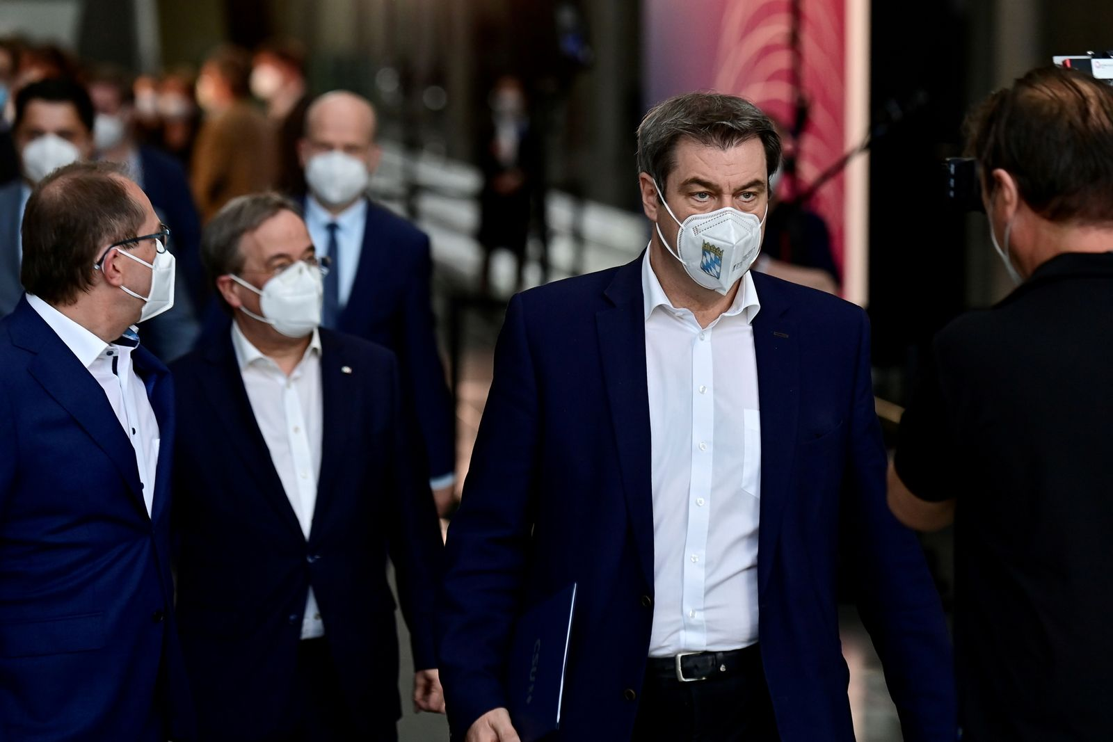 Bavarian State Premier and a leader of the Bavarian Christian Social Union (CSU) Markus Soder leaves following a news conference in Berlin