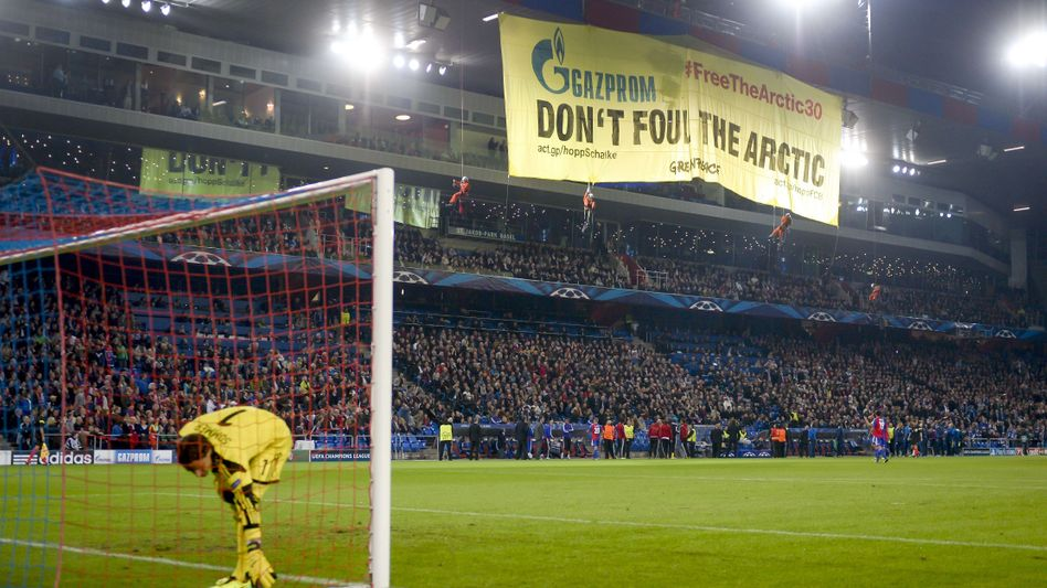 The Greenpeace banner unfurled at FC Basel's stadium on Tuesday night.
