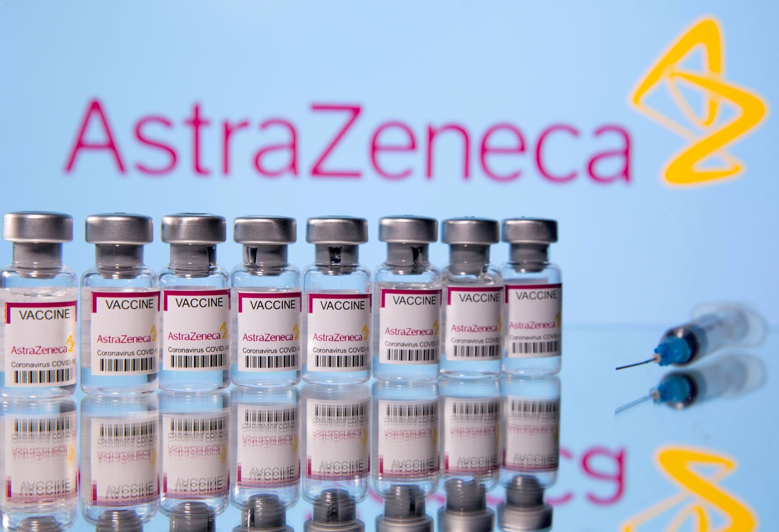 FILE PHOTO: Vials labelled 'Astra Zeneca COVID-19 Coronavirus Vaccine' and a syringe are seen in front of a displayed AstraZeneca logo in this illustration photo