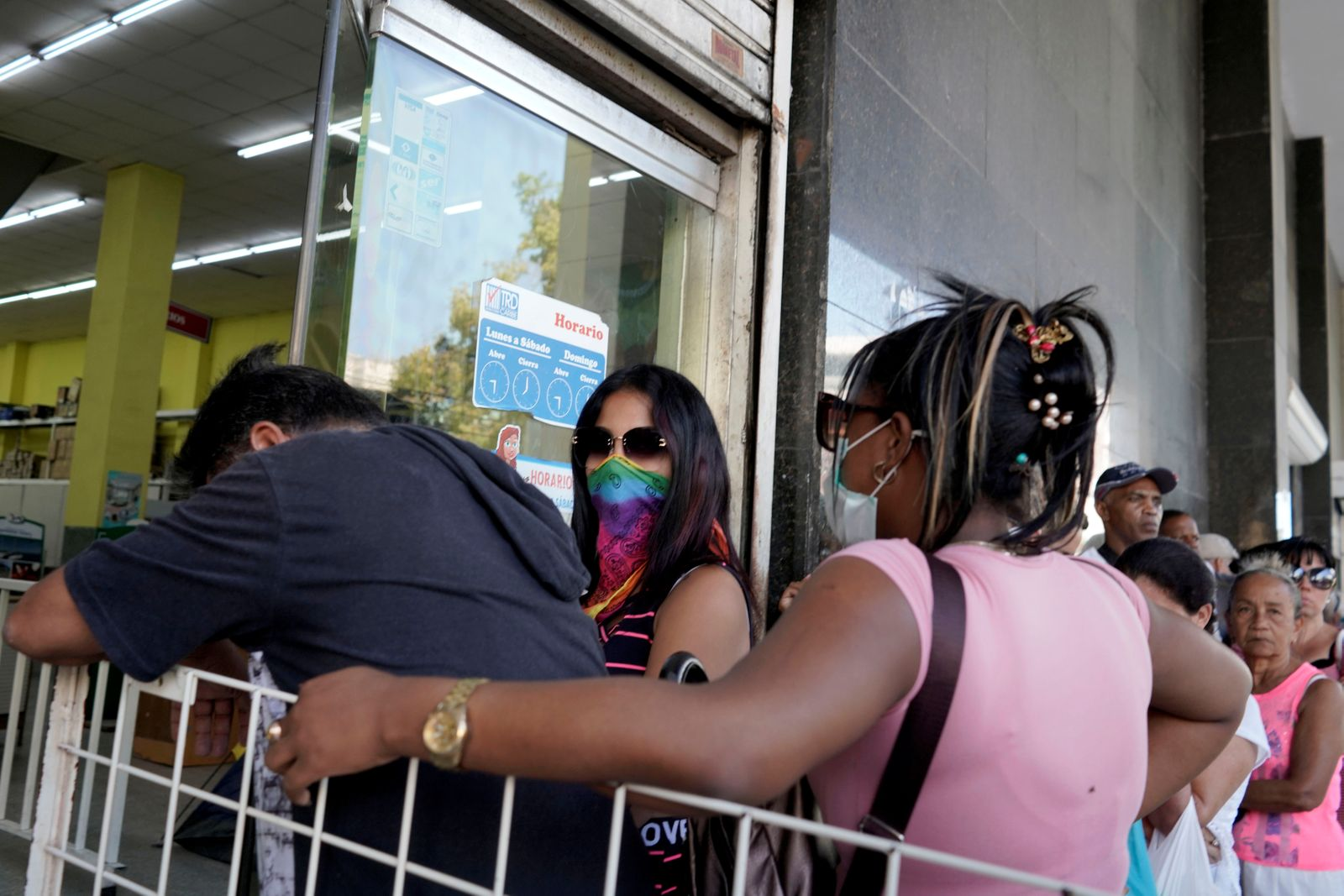 People wait in line to buy goods at a state store amid concerns about the spread of the coronavirus disease (COVID-19) outbreak, in Havana