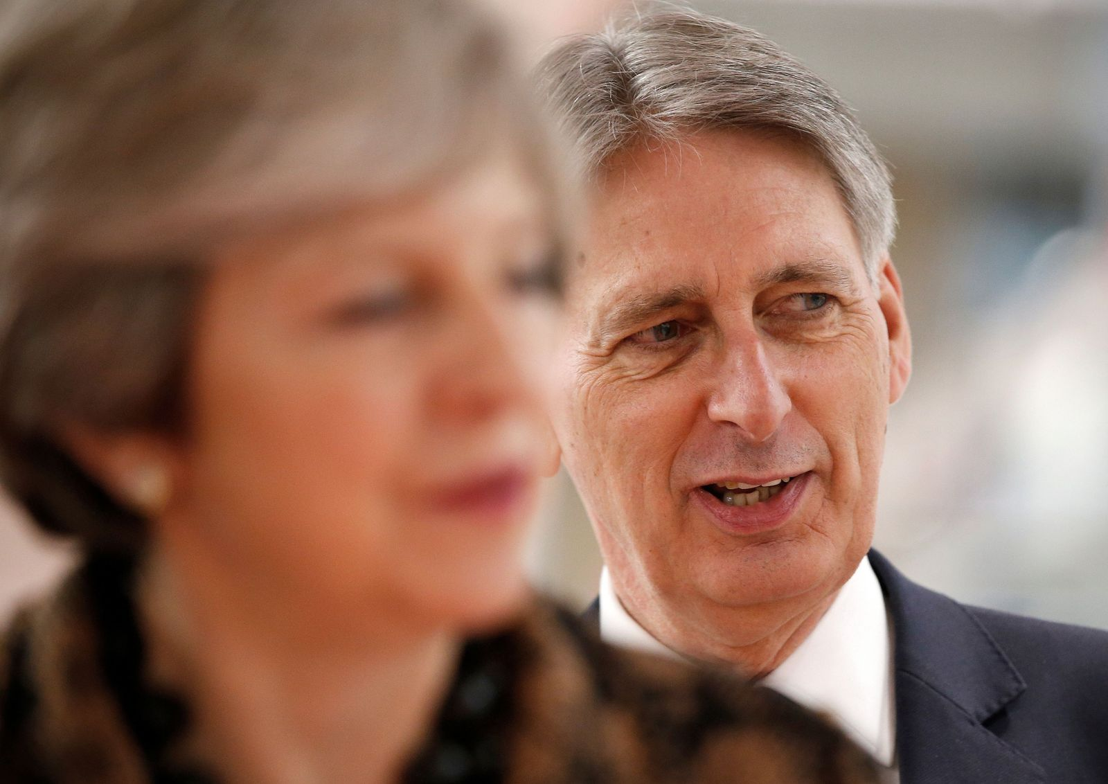 Philip Hammond/ Theresa May