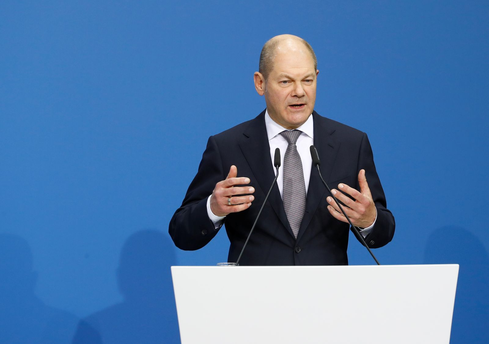 Leader of the Social Democratic Party (SPD) Olaf Scholz speaks prior to signing a coalition deal during a ceremony in Berlin