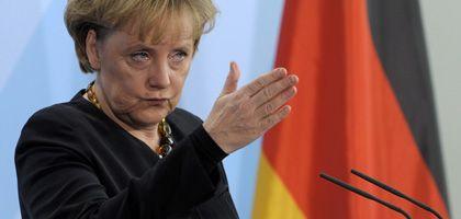Krisenkanzlerin Merkel: Protektionismuskritik trotz eigener staatlicher Schutzprogramme