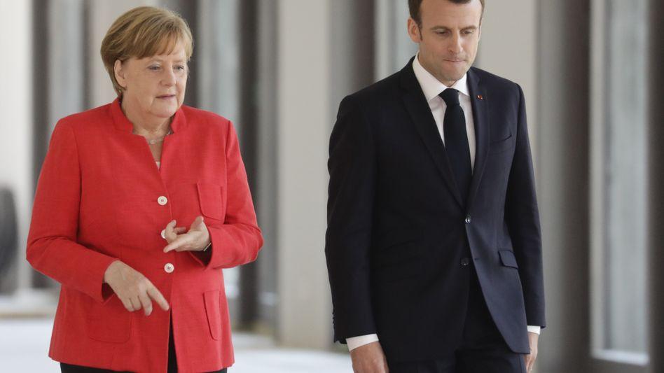 Angela Merkel und Emmanuel Macron im Mai