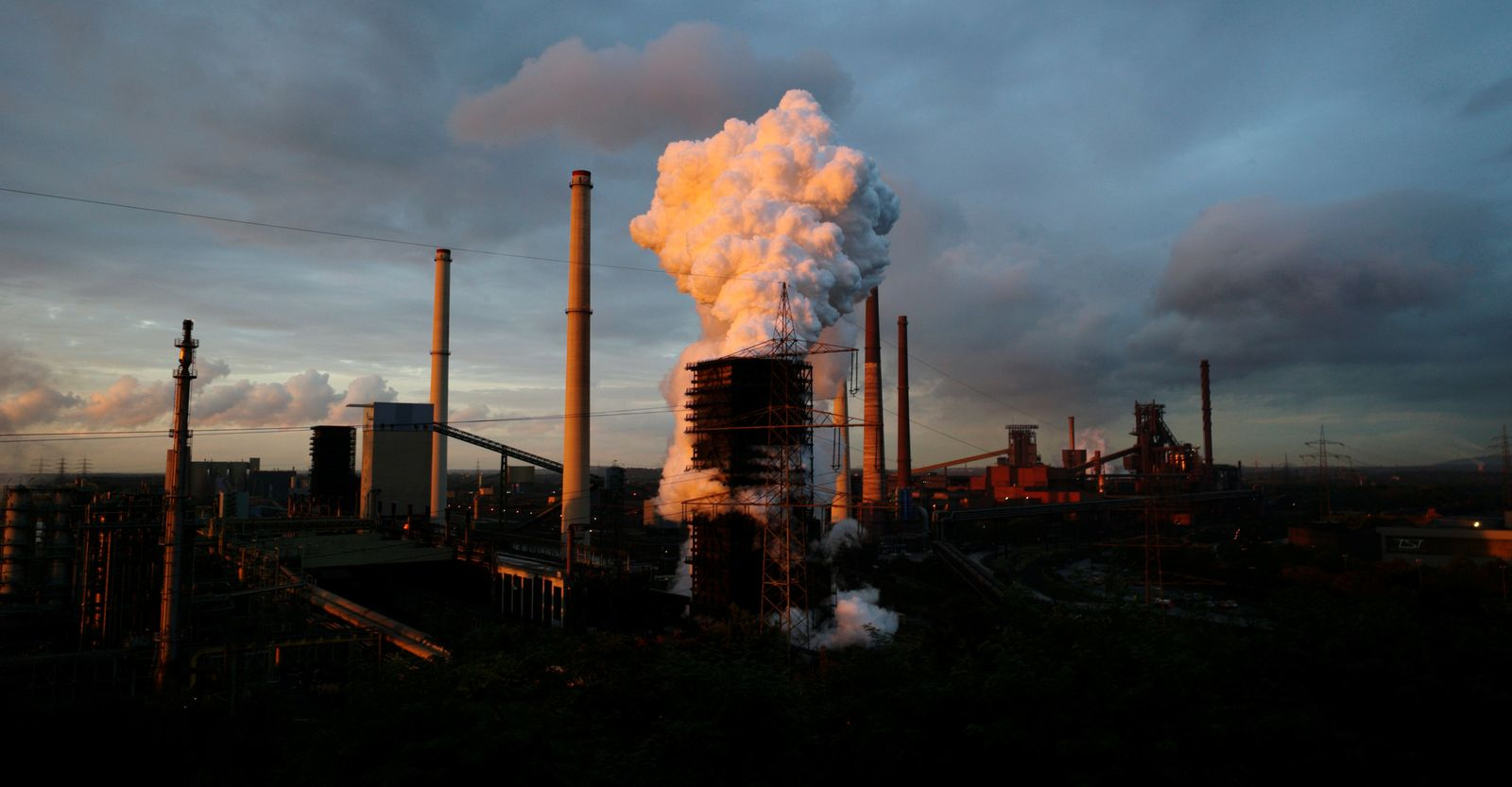 FILE PHOTO: Steam rises at coking plant at steelworks of ThyssenKrupp AG in Duisburg