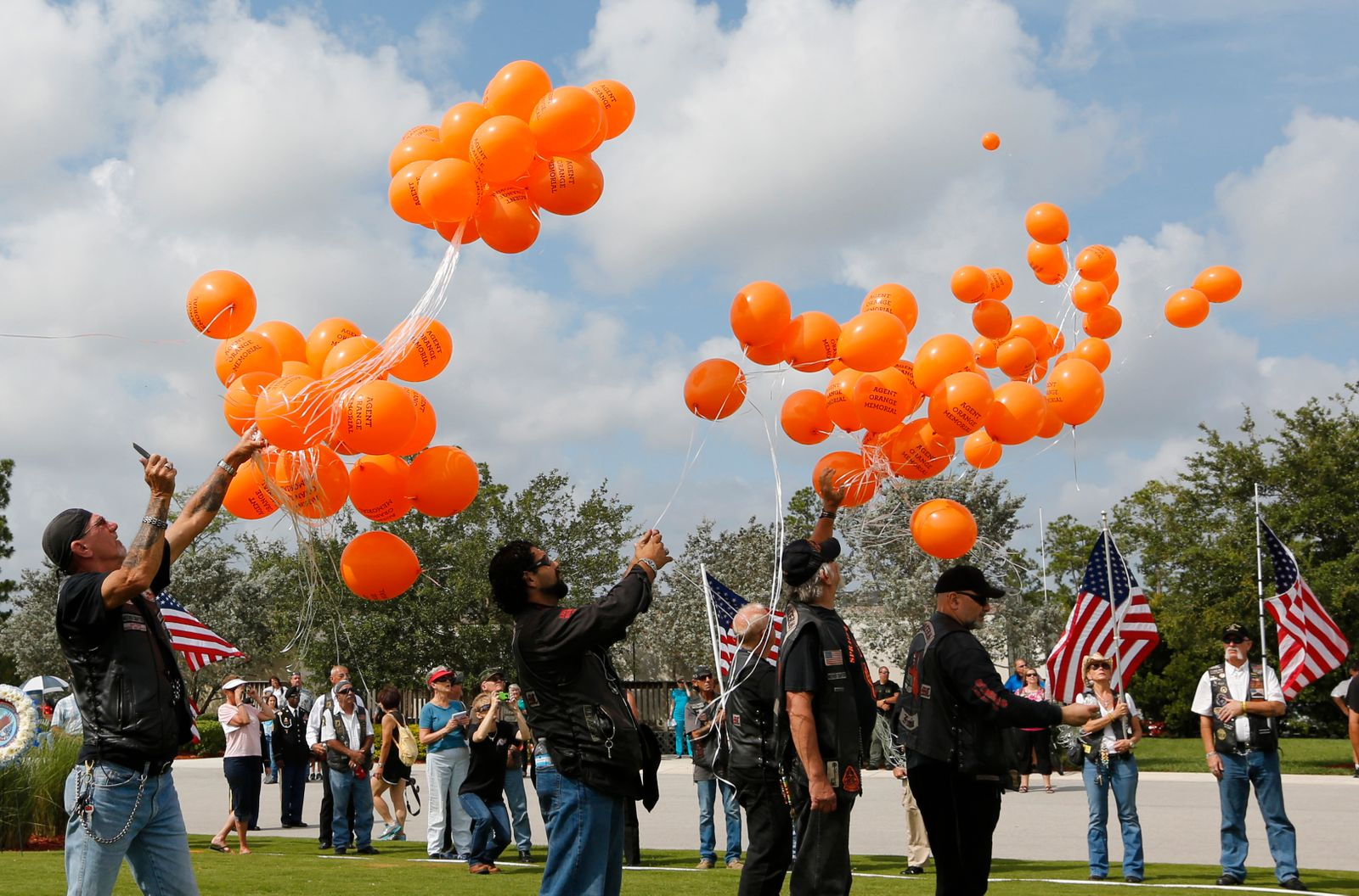 Members of a veteran's group release balloons for the Agent Orange Memorial for those affected by the chemical agent in Vietnam at a Memorial Day Ceremony at the South Florida National Cemetery in Lake Worth