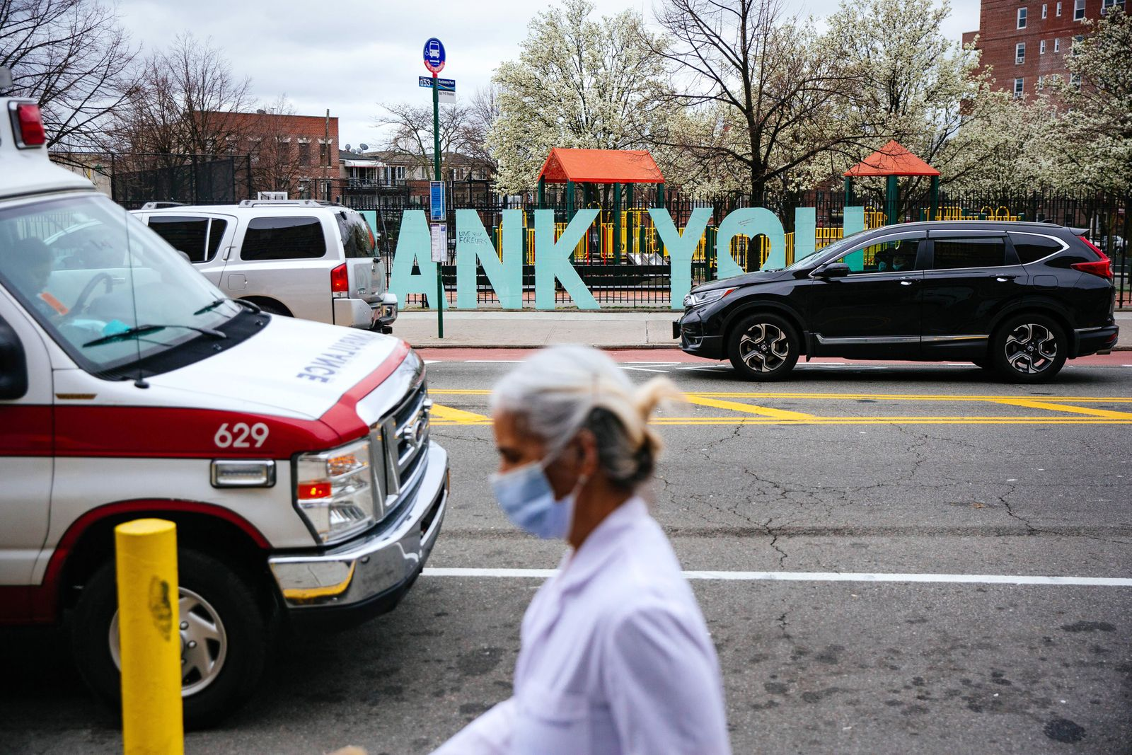 A sign thanking medical personnel, for working in the wake of the coronavirus, is attached to the park fence across from Elmhurst Hospital in Queens, Tuesday, March 31, 2020. (Kevin Hagen/The New York Times)