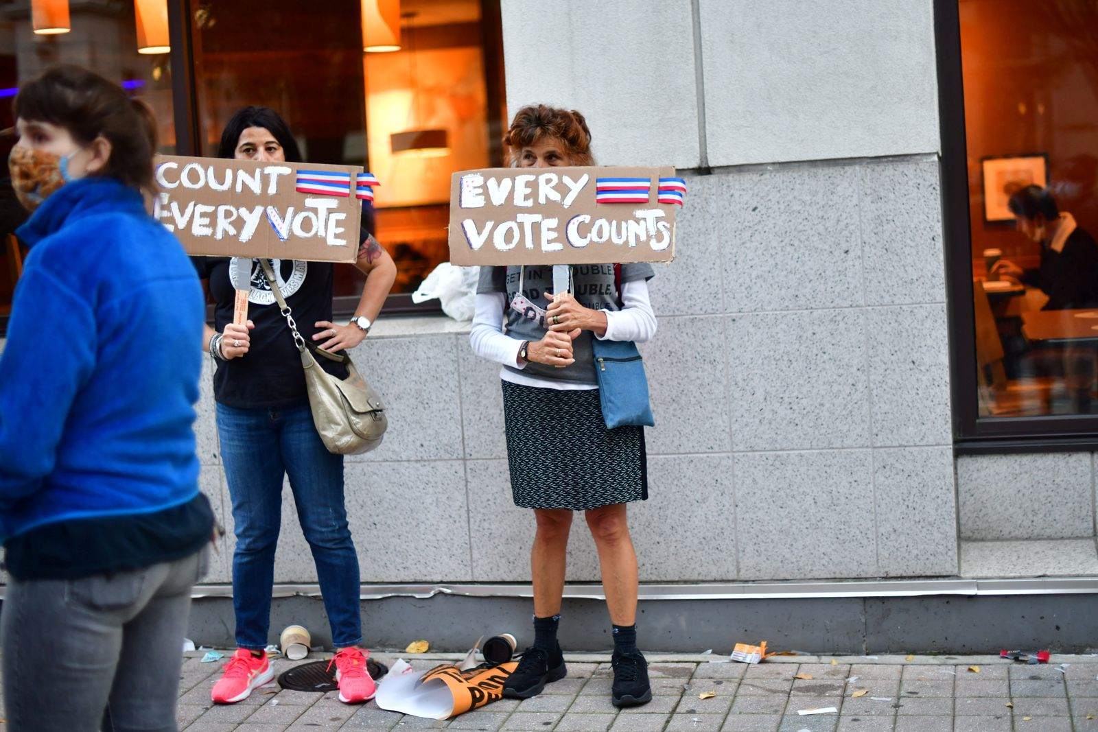 """Activists hold signs stating """"EVERY VOTE COUNTS"""" in Philadelphia"""