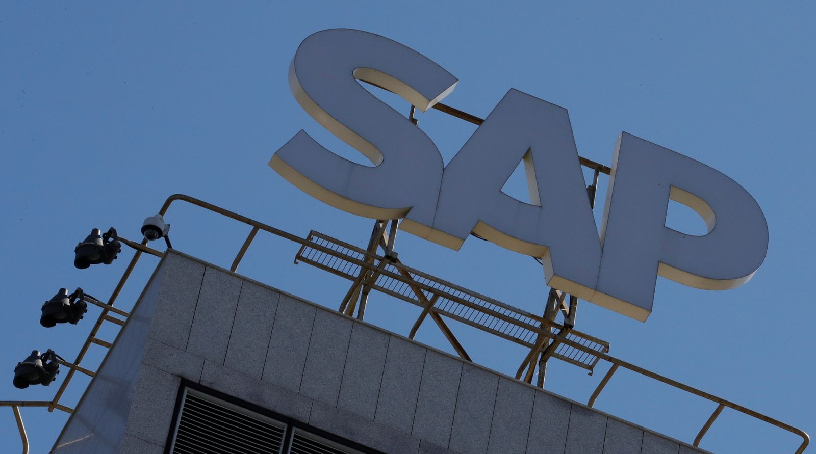 FILE PHOTO: A view shows a sign with the logo of SAP software company on an office building in Moscow