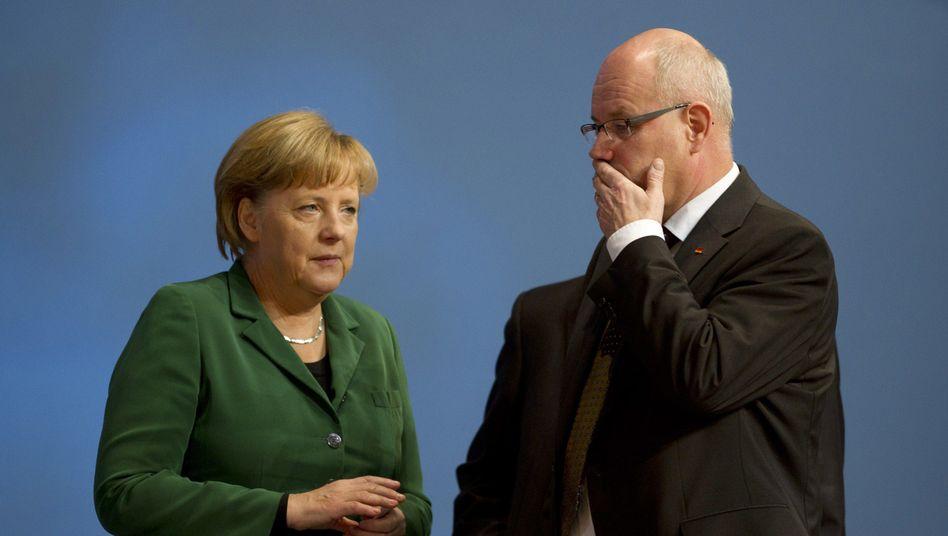 Kanzlerin Merkel, CDU-Fraktionschef Kauder: Schallendes Echo von der britischen Insel
