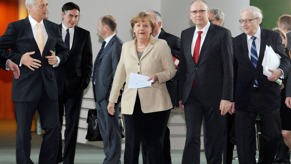 Chancellor Merkel and German state governors held a summit in Berlin on Friday.