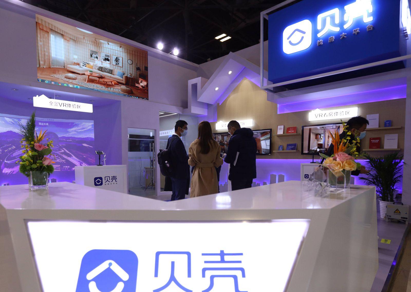 BEIJING, CHINA - NOVEMBER 20: People visit the booth of China s real estate brokerage platform Beike during China (Beiji
