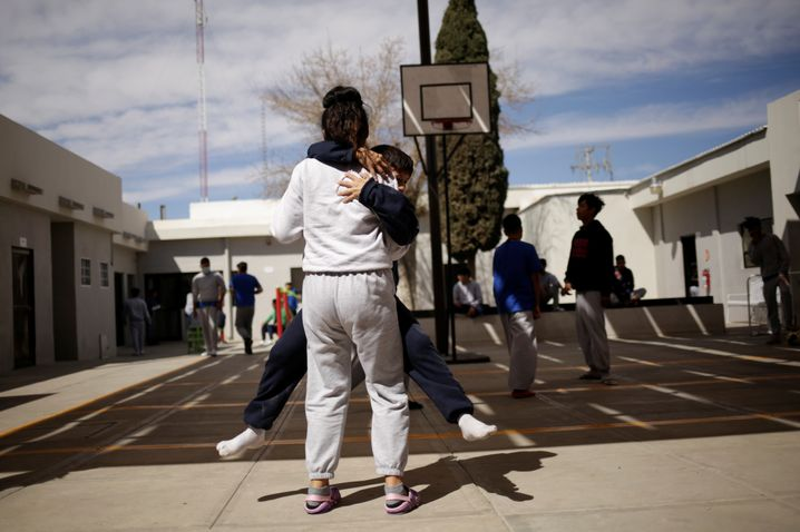 Children play in the yard of the Noemi Alvarez Quillay shelter in Ciudad Juárez, Mexico.