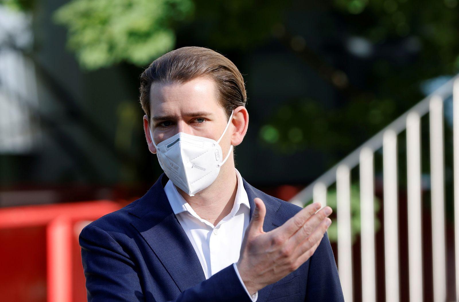 FILE PHOTO: Austria's Chancellor Kurz visits a public school in Vienna