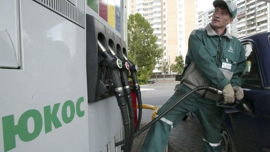 Jukos-Tankstelle in Moskau: Die Ex-Aktionäre wollen sich mit Russland einigen