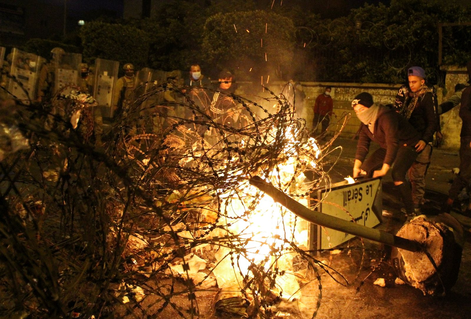 Demonstrators set fire near the government Serail building, during a protest in Tripoli