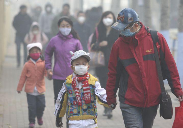 Masken gehören in vielen Städten Chinas zum alltäglichen Utensil