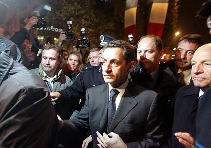 French Interior Minister Nicolas Sarkozy on the Champs Elysees on Saturday. His popularity has not been helped by the rioting.