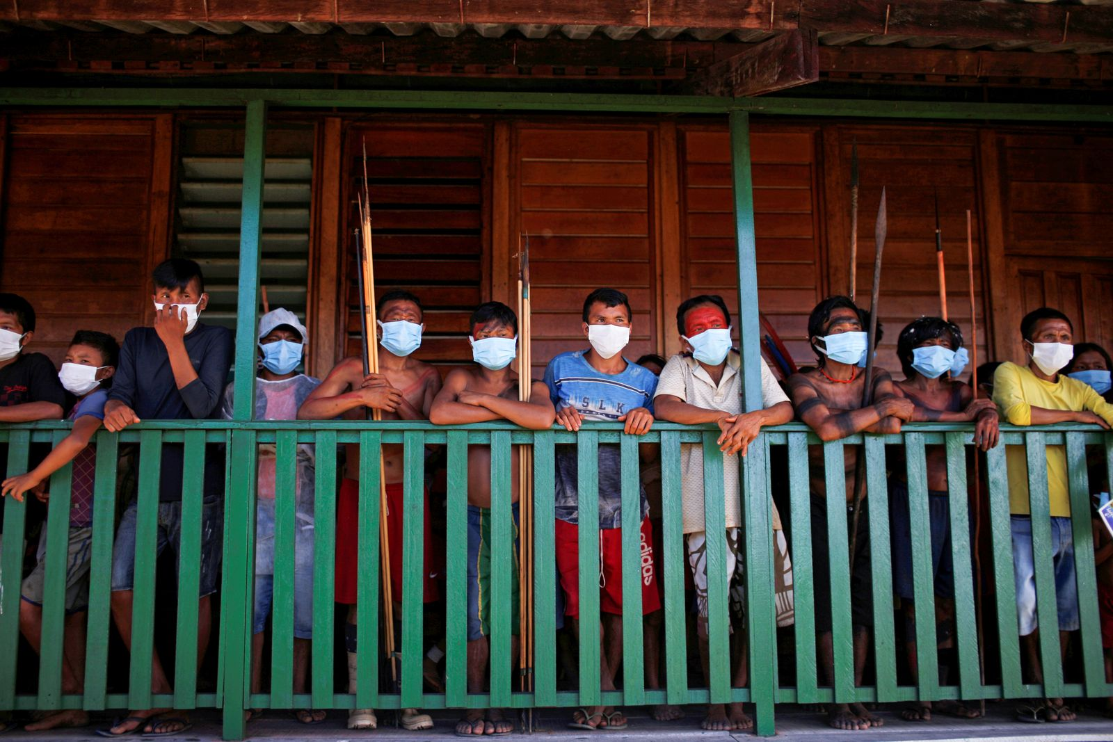 Men from the indigenous Yekuana ethnic group wearing protective face mask look on, amid the spread of the coronavirus disease (COVID-19), at the 5th Special Frontier Platoon in the municipality of Auaris, state of Roraima