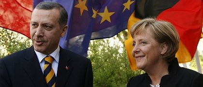"""Turkish Prime Minister Recep Tayyip Erdogan and German Chancellor Angela Merkel: """"As political leaders we will leave our offices one day, but our people will remain and have to get along with each other. So we shouldn't give them negative messages."""""""