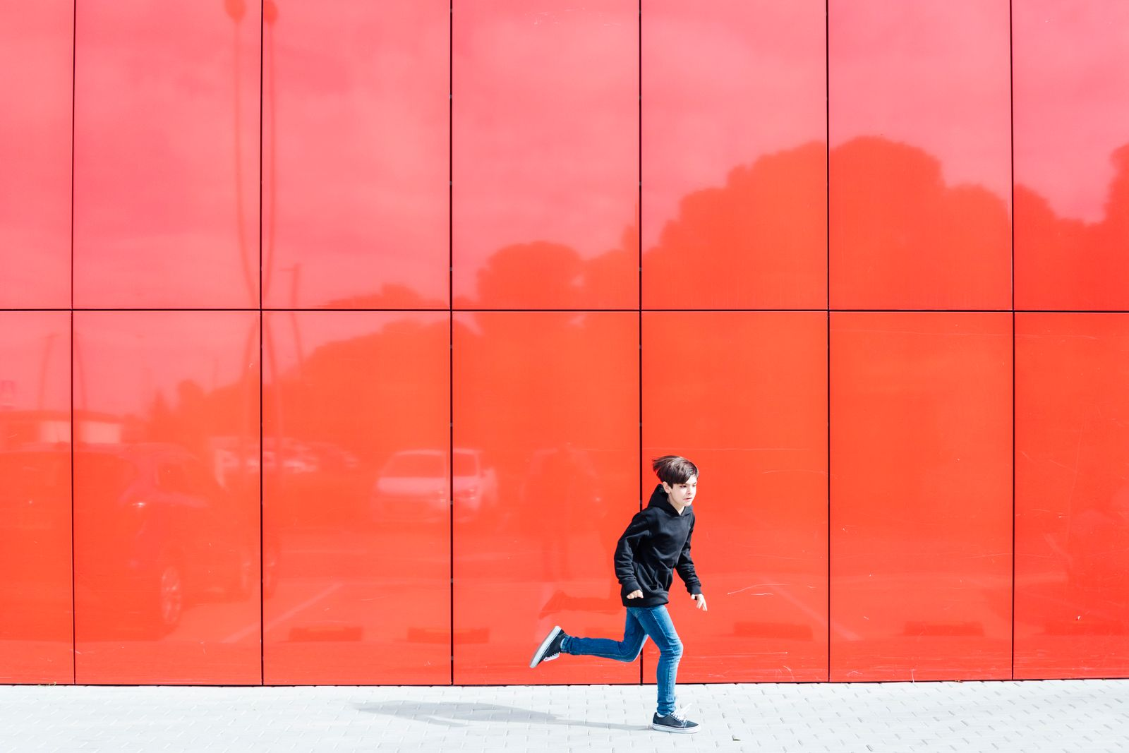 10 year old boy running on red background