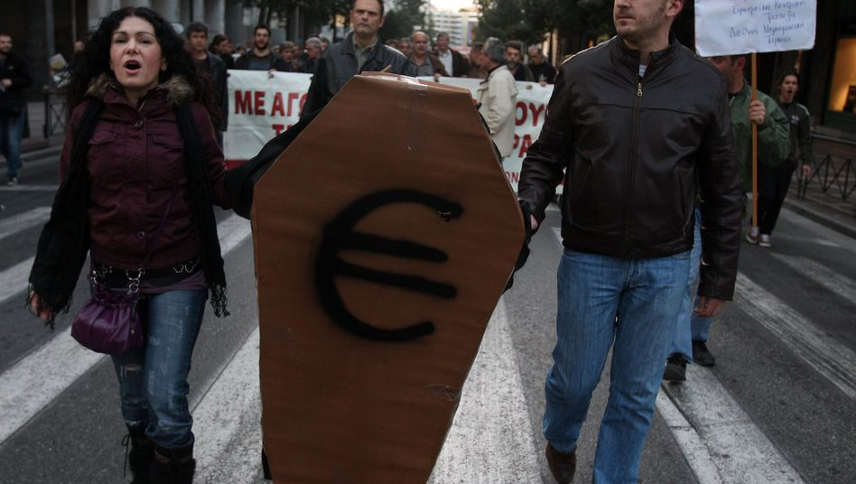 Saving the euro: There are fears that the rescue package will cost more for Germany than promised.