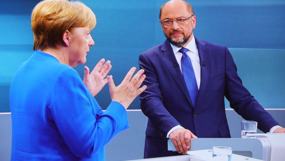 Angela Merkel (CDU) und Martin Schulz (SPD)