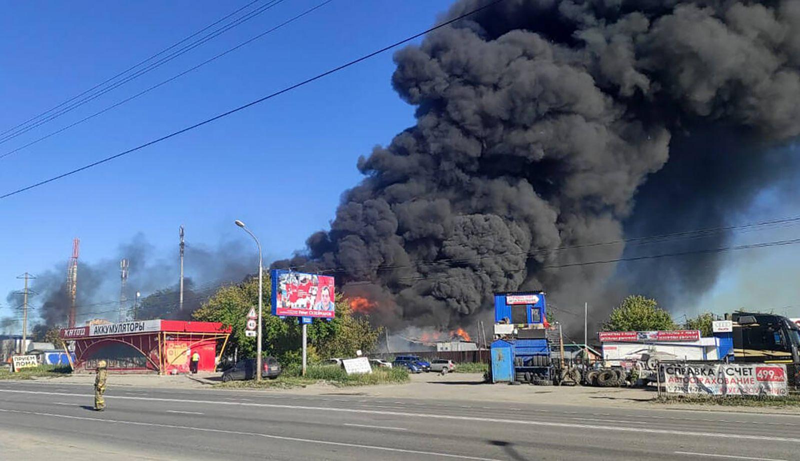 NOVOSIBIRSK, RUSSIA - JUNE 14, 2021: Smoke billows from a fire-hit Yevrogaz fuel filling station on Gusinobrodskoye Hig