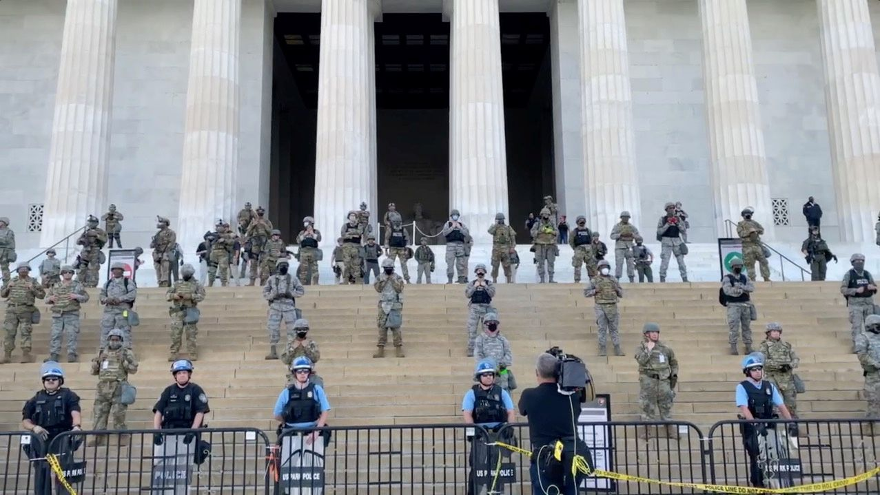 Social media video grab of law enforcement personnel on the steps of the Lincoln Memorial in Washington DC as protests spread across U.S. cities in reaction to the death in Minneapolis police custody of George Floyd