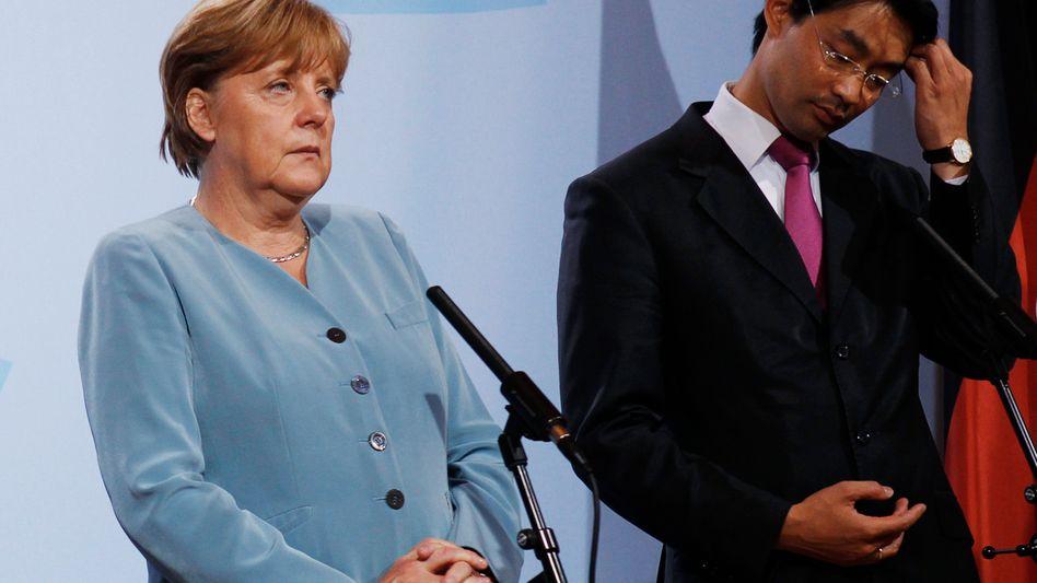 Kanzlerin Merkel, Bündnispartner Rösler: Wohin mit der FDP?