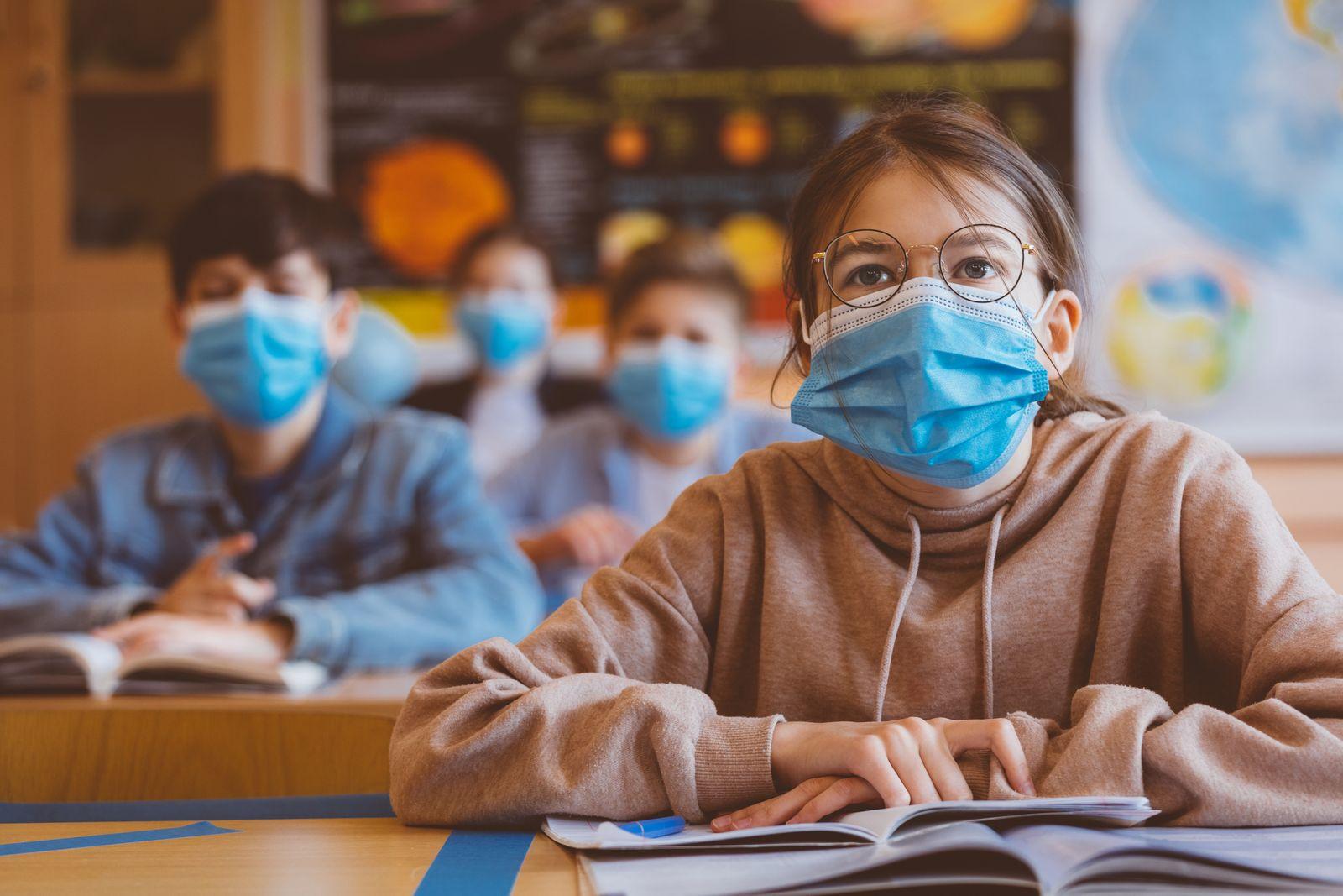 Teenage girl wearing N95 face mask at school