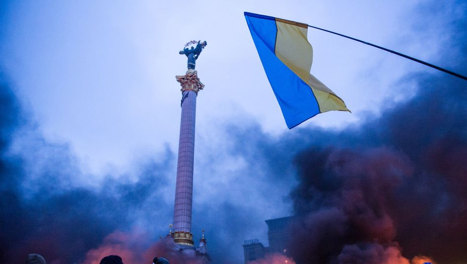 Smoke rising on Independence Square in Kiev on Thursday.