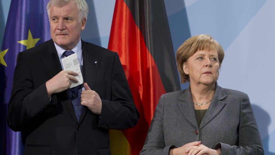 CSU head Horst Seehofer and CDU head Angela Merkel do not always see eye to eye.