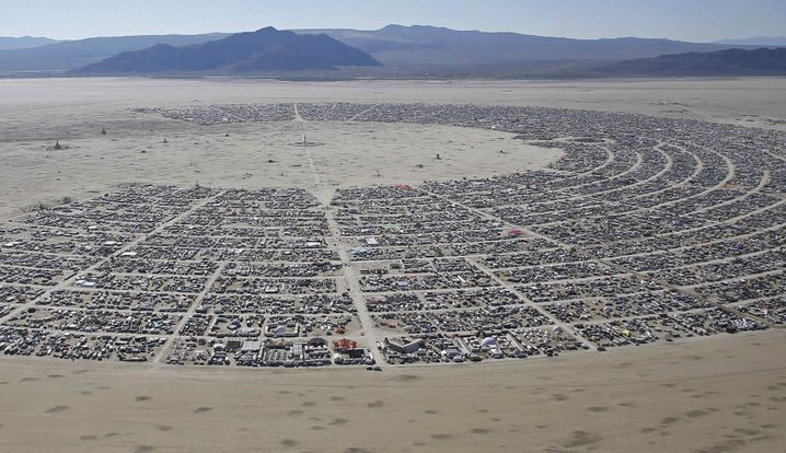 An aerial view during the 2014 Burning Man festival: The tech giants make the pilgrimage each year to the Nevada desert.