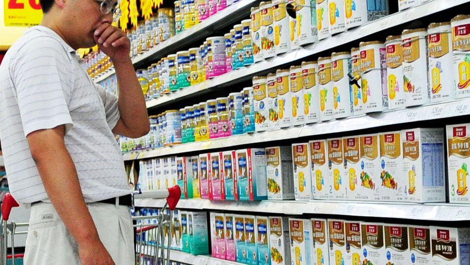 Supermarktkunde (in Peking, Juli 2010): Werbefachleuten ein Schnippchen schlagen
